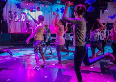 photo of dancing under neon lights